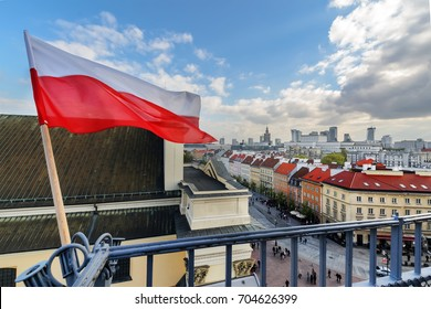 Poland Flag in Blue Sky and the centre of Warsaw in background