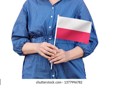 Poland flag. Close up of woman's hands holding a national flag of Poland isolated on white background.