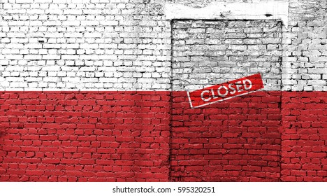 Poland flag on brick wall with bricked door and Closed sign