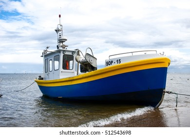 POLAND, GDANSK, 13 August, 2016: Yellow boat on coast in Gdansk