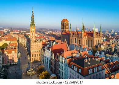 Poland. Gdansk Old City skyline with medieval Gothic Saint Mary Cathedral, city hall with clock tower, Dluga street, Neptune statue with fountain, Artus Court. Aerial view in sunrise light
