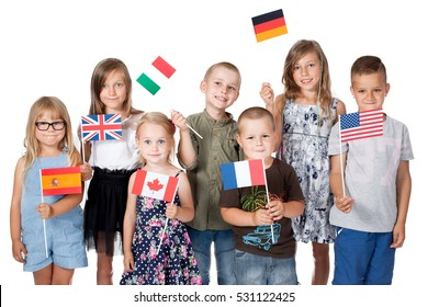 poland group holding flags of different countries. German flag, flag england, spain ,america,russia, france flag, canada