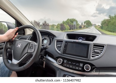 POLAND - July 13, 2018: Man driving Honda CR-V.