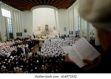 POLAND, KRAKOW - MAY 28, 2016: Sanctuary in Lagiewniki. Basilica of the Divine Mercy.People in prayer