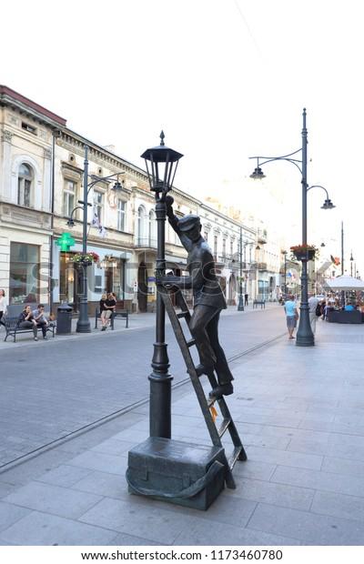 POLAND,  LODZ, PIOTRKOWSKA STREET - JULY 06, 2018: Statue of the lamp man  on Piotrkowska Street in Lodz