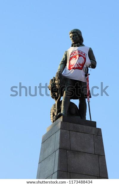 POLAND, LODZ, WOLNOSCI SQUARE - JULY 06, 2018: The statue of the Polish freedom fighter Tadeusz Kosciuszko wears a polish jersey.