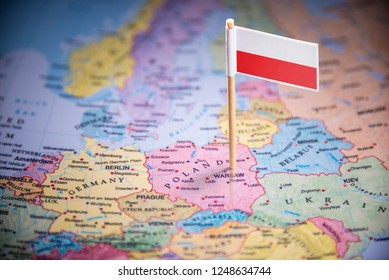 Poland marked with a flag on the map