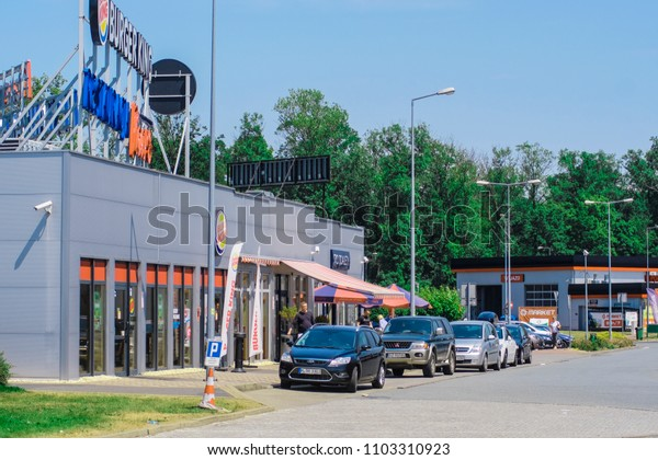 Poland - May, 31, 2018: cars on a parking near highway in Poland