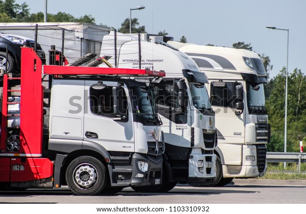 Poland - May, 31, 2018: Trucks on a parking near a highway in Poland