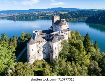 Poland. Medieval Castle in Niedzica, 14th century (upper castle), Polish or Hungarian in the Past. Artificial Czorsztyn Lake and far view of the ruins of Czorsztyn castle. Aerial view in the morning