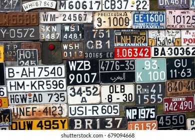 POLAND, OTREBUSY, 31 March 2017: many number plates of old cars from all around the world