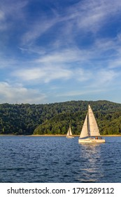 Poland. Podkarpackie voivodeship. Bieszczady, Zalew Solinski, Solina 01/08/2015 - two sailboats on the Solina lake, summer.
