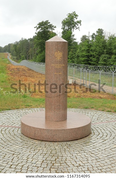 POLAND, PODLASKIE VOIVODESHIP, SUWALKI COUNTY, JODOZIORY - JULY 02, 2018: A granite column marks the tripoint between Poland, Lithuania and Russia.