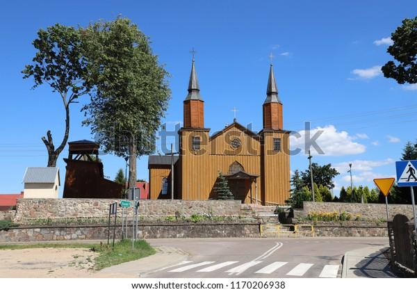 POLAND, PODLASKIE VOIVODESHIP, SUWALKI COUNTY, JELENIEWO - JULY 05, 2018: The Holy Heart of Jesus Church iin Jeleniewo is a wooden church in  north-eastern Poland.
