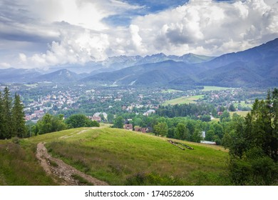 Poland. Polish Tatry mountains. View of the cloudy mountains. In the valley the city of Zakopane.