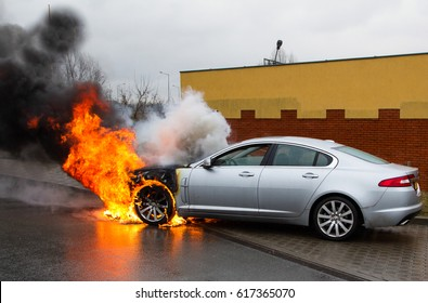 Poland Pozna  2017 Year .February 25 . Burning car on the road in Pozna  Poland