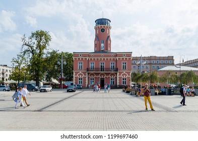 CZĘSTOCHOWA, POLAND - September 2, 2018: Pink concrete building under blue sky.