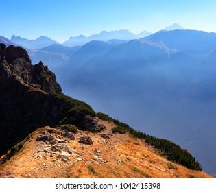 Poland, Tatra Mountains, Zakopane - Suchy Wierch Kondracki peak with High Tatra mountain range panorama in background