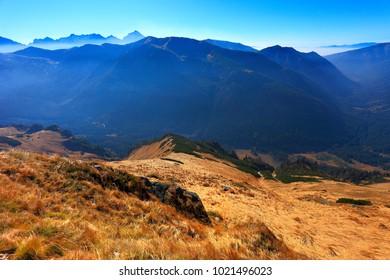 Poland, Tatra Mountains, Zakopane - Wierchcicha Valley and Cichy Wierch peak with High Tatra in background