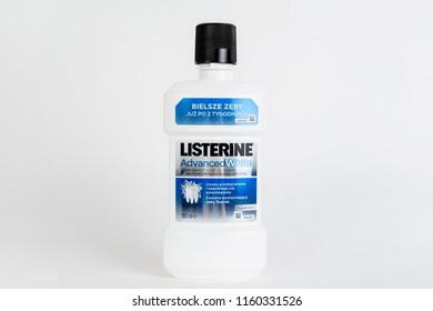 POLAND, TYCHY - AUGUST 20, 2018: LISTERINE mouthwash bottle. A white bottle with a blue LISTERINE brand logo. Caring for oral hygiene, clean teeth.