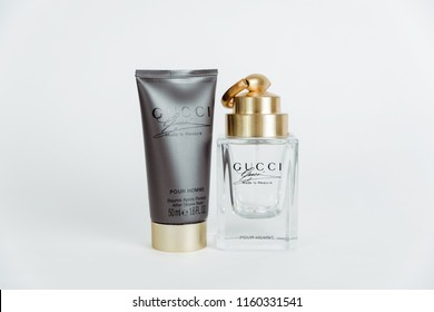POLAND, TYCHY - AUGUST 20, 2018: Set of after shave balm and transparent Gucci perfume bottle for men with golden plug. Luxury perfumes for men and women Gucci.