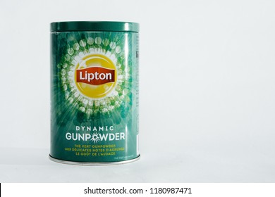 POLAND, TYCHY - SEPTEMBER 16, 2018: Container with tea LIPTON. View of the green container with LIPTON teas. The concept of drinking black express tea.
