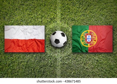 Poland vs. Portugal flags on green soccer field