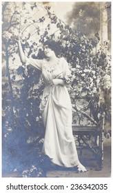 POLAND, WARSAW - CIRCA 1915: old photo  of young woman in garden.