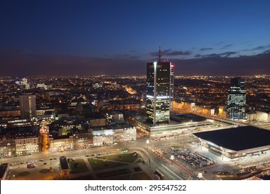 Poland, Warsaw, city centre at night from above, Central Train Station (Warszawa Centralna) on bottom right