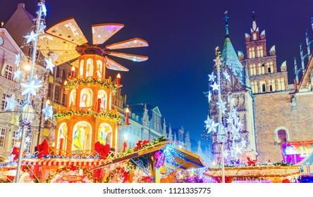Poland, Wroclaw. Lovely night scene of Christmas market on central square in Polish touristic city Wroclaw. Popular romantic travel destination on Christmas in Europe.