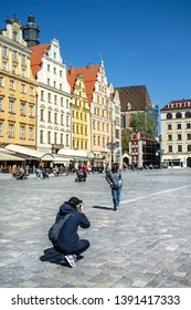 Poland. Wroclaw. Tourists on the main square. April 2019