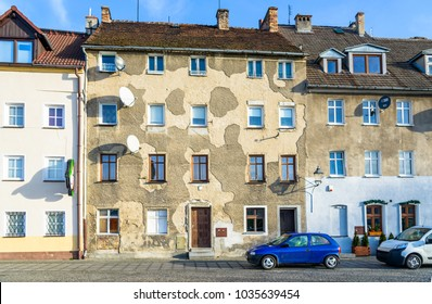 Poland, Zgorzelec 28 December 2017: Background, a Street with a building which requires renovation of the facade with parked cars near