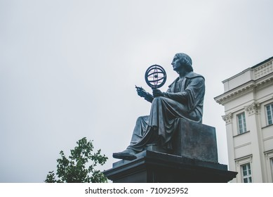 Poland's capital Warsaw on early August morning. Central part of the city. Monument to famous Polish scientist Nicolaus Copernicus