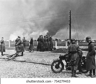 Poland's Capital Warsaw under bombing by the German Luftwaffe, ca. Sept. 8-15, 1939. German troops in foreground reached the suburbs of Warsaw on Sept. 8 and by the Sept. 15th Polish defenders were pu