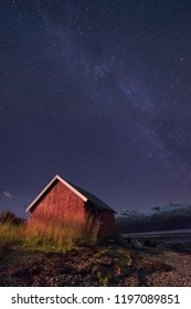 The polar arctic milky way galaxy  sky star in Norway Tromso in the farm village  mountains with trees