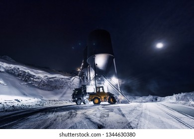 The polar arctic night sky star in Norway travel Svalbard in Longyearbyen city the moon mountains coal loading at the mine
