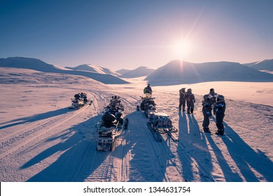The polar arctic Northern light pink sunset sky star in Norway travel Svalbard in Longyearbyen city  mountains travel snowmobile tour