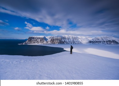The polar arctic Northern light pink sunset sky star in Norway travel Svalbard in Longyearbyen Tempelfjorden  mountains travel snowmobile tour