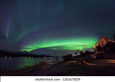 The polar arctic Northern lights aurora borealis sky star in Scandinavia Norway Tromso in the farm village  mountains