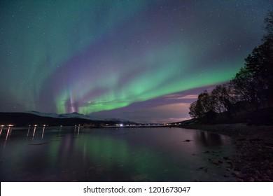 The Polar Arctic Northern Lights Aurora Borealis Sky Star In Scandinavia Norway Tromso Farm