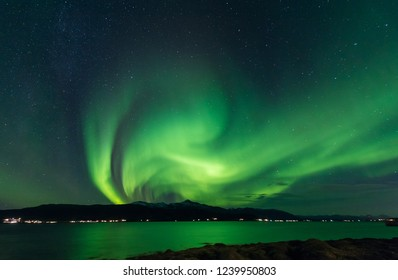 The polar arctic Northern lights aurora borealis sky star in Scandinavia Norway Tromso Svalbard mountains