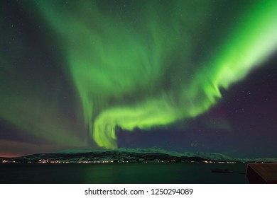 The polar arctic Northern lights aurora borealis sky star in Norway Svalbard in Longyearbyen city  mountains