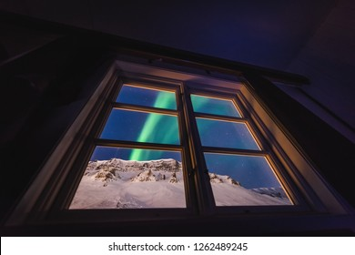 The polar arctic Northern lights aurora borealis sky star in Norway Svalbard in Longyearbyen city  mountains view of the hotel window