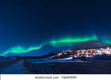 The polar arctic Northern lights aurora borealis sky star in Norway Svalbard in Longyearbyen the moon mountains
