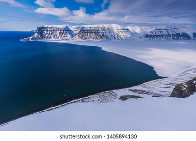 The polar arctic Northern  sky in Norway travel Svalbard in Longyearbyen Tempelfjorden  mountains travel snowmobile tour