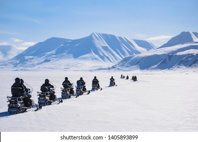 The polar arctic Northern  sunset sky  in Norway travel Svalbard in Longyearbyen city  mountains travel snowmobile tour