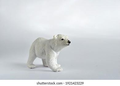 Polar bear on a white field. Children's toy.