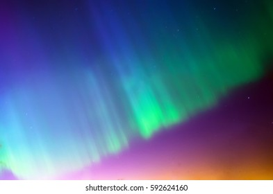 Polar northen Lights aurora borealis. Sky night stars