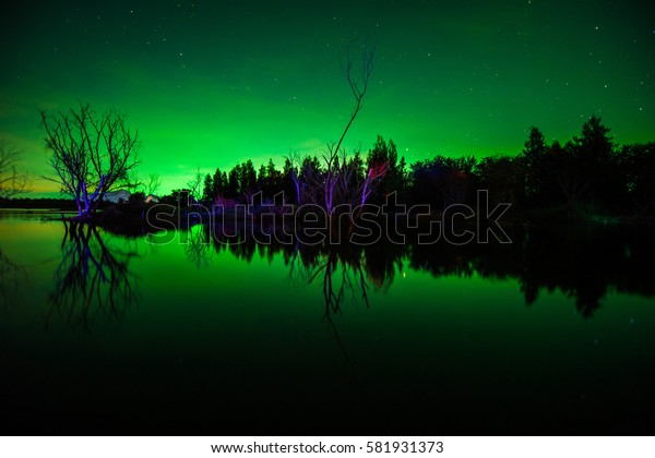 The polar Northern lights in Norway Svalbard in the mountains  ,  Dark night sky beautiful green