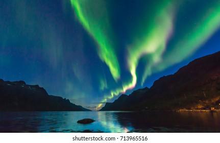 The polar Northern lights in Norway.Tromso.Ershfjord